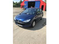 Peugeot 206; nippy and reliable, interior excellent condition.