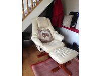 2 cream recliners with footstools