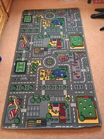 Large, brightly coloured road play rug