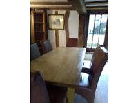 Dining Table solid heavy wood and 6 tan leather chairs