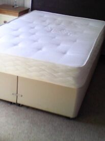 Double bed, Mattress and brown headboard