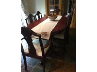 Mahogany extendable table and 6 chairs newly covered seat pads in very good condition
