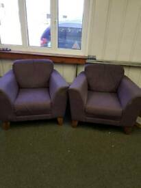 2 purple comfy chairs