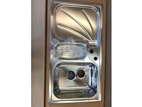 Stainless steel kitchen sink from Reginox .Brand new still in box with all the accessories.