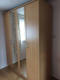 Large double wardrobe with mirror doors and shelving