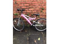 Two pink bikes