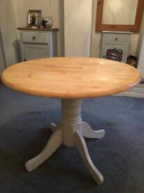 Round pine table and four chairs