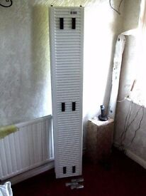 NEW DOUBLE RADIATOR. Fits under a Lounge window. Ordered in error now to clear.