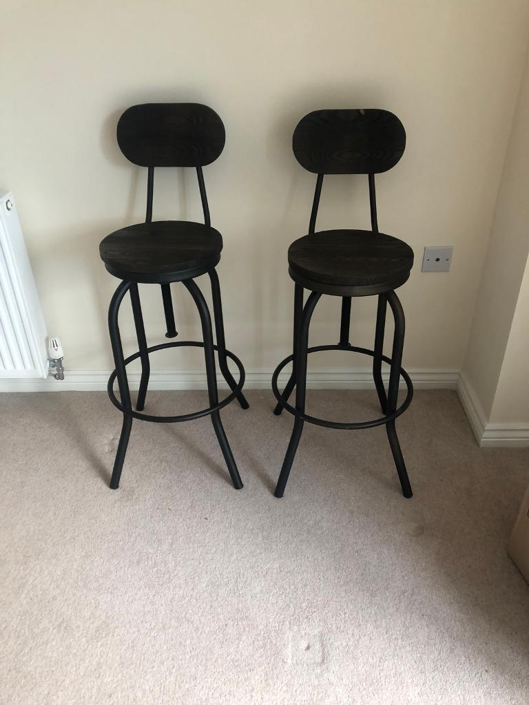 Dark wood and metal bar stools cost £298