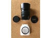 Panasonic Lumix 45-150 OIS m43 lens with hood and filter, used only a few times