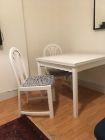 White wooden table and two chairs