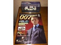 James Bond car collection with magazine