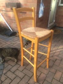 Tall pine bar stool/chair with rush type . Seat height 705mm. Total height 1001mm
