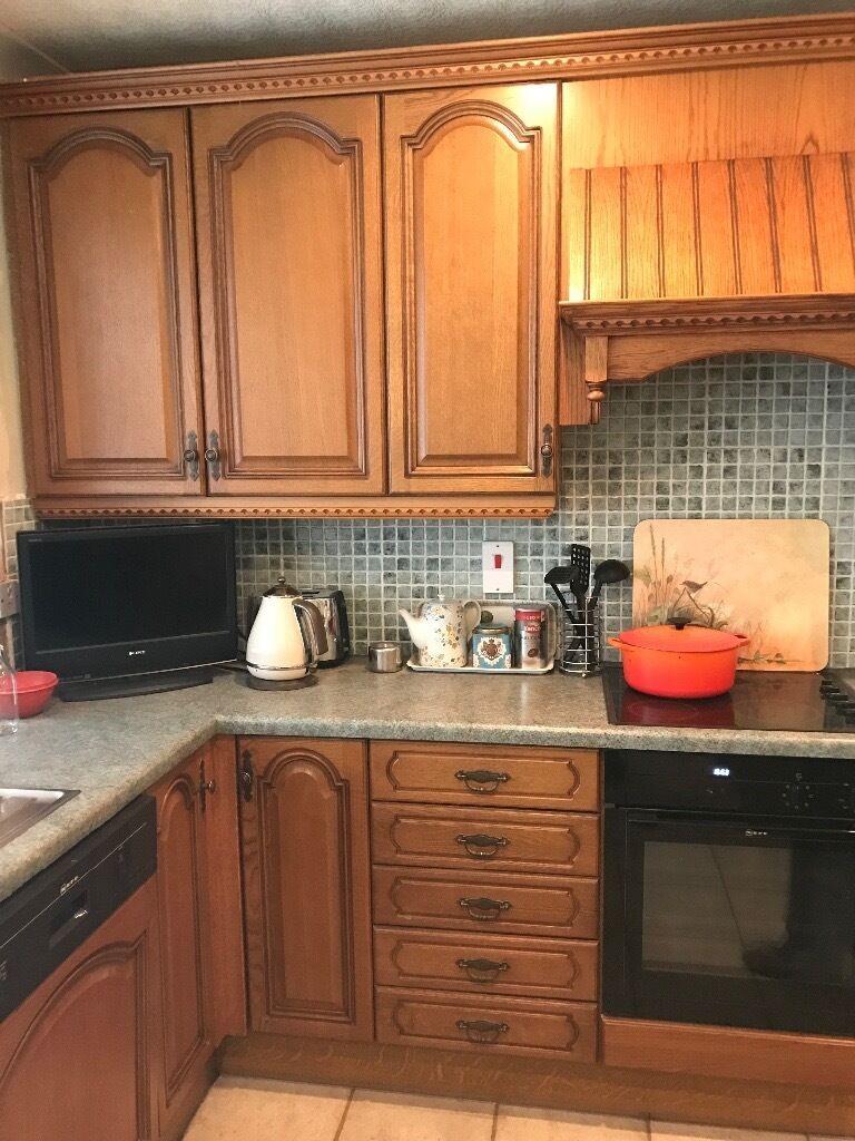 solid medium oak kitchen including intergrated neff appliances and solid medium oak kitchen including intergrated neff appliances and double stainless steel sink