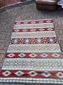 Purple crewel rug