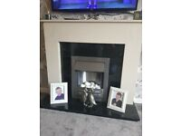 Marble fire surround and electric fire