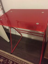 Red reading glass table