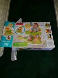 Fisher price sit me up in box.