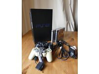 Sony Playstation 2 with controllers and games