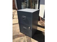 Metal 2 drawer filing cabinet in grey.