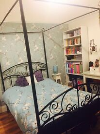 Four Poster Bed Frame. Black metal. Attractive