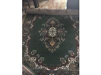 Dark green multi rugs