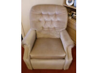 Beige manual reclining armchair in good condition.
