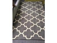 Grey Arabesque wool rug brand new.