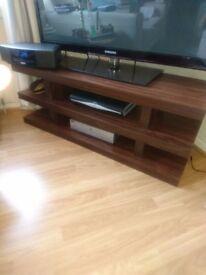 Dark wood effect TV unit.