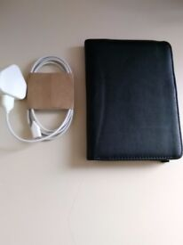 Amazon Kindle WiFi 6inch touch screen metallic grey eReader with black case & charging cable.