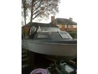 Europa 4 centre cockpit cabin cruiser 4 berth convertable boat trailer and outboard