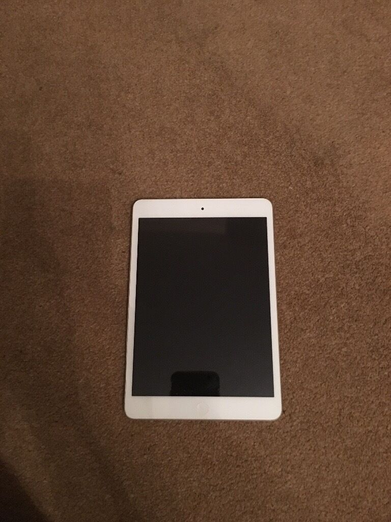 White iPad mini 16GB. Brand new condition, rarely used, includes case