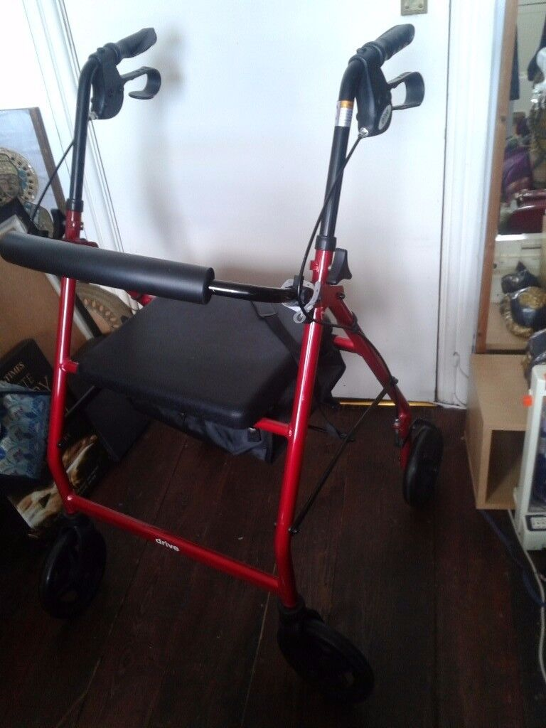 Red rollator - walking frame with seat and small basket