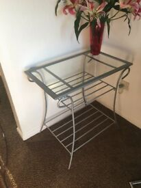 Silver metal and glass table