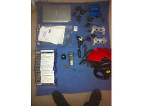 PS2 SILVER WITH 23 GAMES AND EXTRAS
