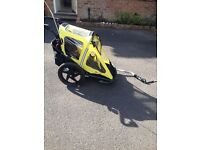 Bike trailer that can be converted to stroller, folds for easy storage