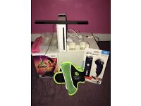 White Nintendo Wii with Zumba game and extras