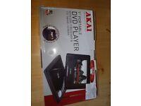 As new Akai portable DVD player in box