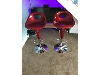 2x red adjustable bar/kitchen stools