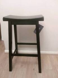 Brand new black solid wood heavy saddle stool rrp £35