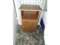 brown wood bedside cabinet