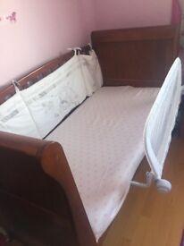 Sleigh cot bed in dark finish with mattress,
