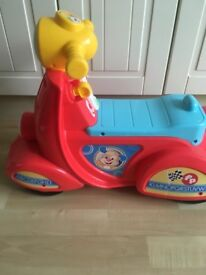 Ride on fisher price scooter