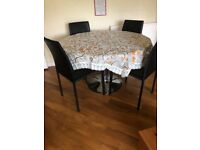 Dining table with leather chairs