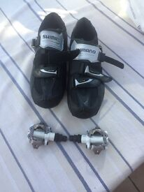 Shimano cycling shoes with free pair of cleats