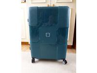 Large lightweight 4 wheelie suitcase with TSA combination lock.