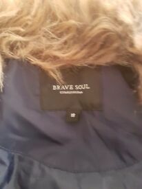 Brand new blue jacket .fur collor