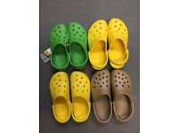 4 pairs of Crocs in assorted colours - in size M9/W11