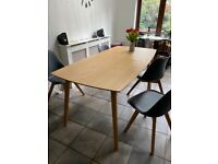 Oak dinner table and six chairs