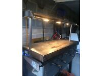 Hot plate with heat lamps